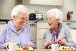 Senior women enjoying meal together at home
